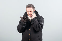 Nervous male having a conversation on cellphone Royalty Free Stock Photo
