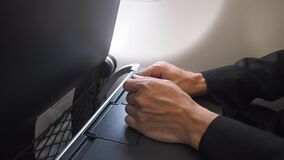 Nervous male passenger hand shaking when sitting in aircraft. Symptom on plane phobia.