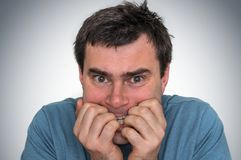 Nervous man biting his nails - nervous breakdown. Concept Royalty Free Stock Images