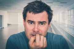 Nervous man biting his nails - nervous breakdown. Concept - retro style royalty free stock photos