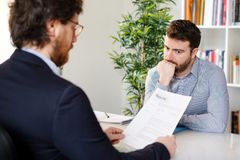 Nervous man during a job interview royalty free stock photography