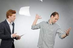 Nervous man throwing papers Stock Image
