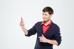 Nervous man using smartphone. Isolated on a white background Royalty Free Stock Images