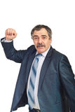 Nervous mature businessman showing fist. Nervous and confused mature business man showing his fist isolated on white background Royalty Free Stock Photography