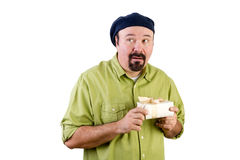 Nervous middle aged man with wrapped present Stock Images