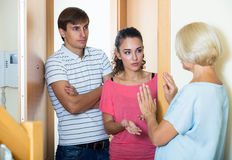 Nervous neighbors coming to old lady with complains Royalty Free Stock Photo