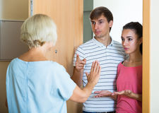 Nervous neighbors coming to old lady with complains royalty free stock photos