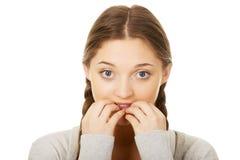 Nervous pensive woman biting nails. Stock Photos