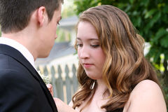 Nervous Prom Girl Fixing Boutonniere Stock Photography
