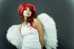Nervous Redhead with Wings Stock Photography