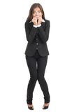 Nervous scared businesswoman. Nervous scared woman biting her nails. Funny asian businesswoman isolated in full length on white background. Mixed caucasian / royalty free stock photo
