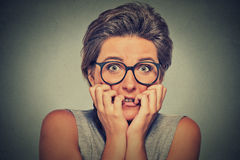 Nervous stressed anxious young woman with glasses girl biting fingernails Royalty Free Stock Photos