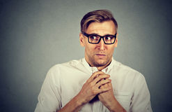 Nervous stressed man feels awkward anxiously craving something. Nervous stressed young man student feels awkward looking away sideway anxiously craving something Royalty Free Stock Photography