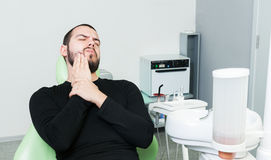 Nervous and stressed patient at dentist Royalty Free Stock Images