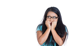 Nervous student with eyeglasses biting fingernails Royalty Free Stock Photo