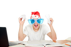 Nervous student in santa's hat. And big blue glasses. isolated on the white background Royalty Free Stock Photos
