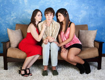 Nervous Teen with Girls. Nervous young men with beautiful girls sitting next to him Stock Image