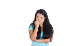 A nervous teenager biting her nails. Closeup portrait of a nervous woman biting her nails craving for something or anxious, isolated on white background with Royalty Free Stock Images