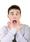 Nervous Teenager. Strangle himself Isolated on the White Background Stock Image