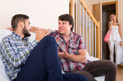 Nervous wife suspecting husband in affair Stock Photos
