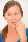 Nervous woman biting finger Stock Photography
