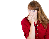 Nervous woman biting her nails craving for something or anxious Royalty Free Stock Photography