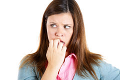 Nervous woman biting her nails craving for something or anxious Royalty Free Stock Photos