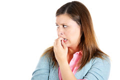 Nervous woman biting her nails craving for something or anxious Royalty Free Stock Photo