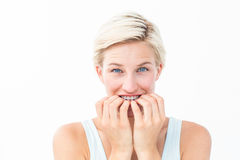 Nervous woman biting her nails looking at camera Royalty Free Stock Photo
