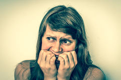 Nervous woman biting her nails - retro style royalty free stock photography