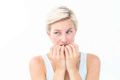 Nervous woman biting her nails Royalty Free Stock Photography