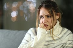 Free Nervous Woman Biting Nails At Night In Winter Stock Photos - 166412013