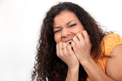 Nervous woman biting nails Stock Photography