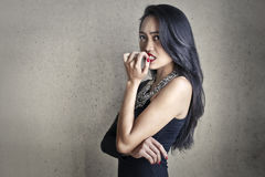 Nervous woman. Bitting her nails Stock Images