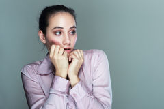 Nervous woman Stock Images