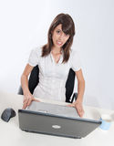 Nervous woman at her desk Stock Photography