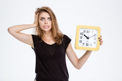 Nervous woman holding wall clock Royalty Free Stock Photography