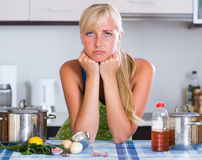 Nervous woman at home kitchen Stock Photography