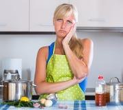 Nervous woman at home kitchen Stock Photos