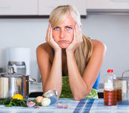 Nervous woman at home kitchen Royalty Free Stock Image