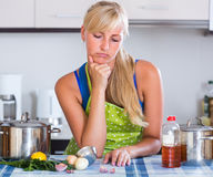 Nervous woman at home kitchen Stock Photo