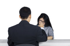 Nervous woman in job interview Stock Photo