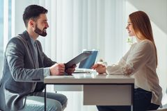 Free Nervous Woman Looking At Manager Reading Her Resume During A Job Interview At Office Stock Image - 159874511