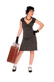 Nervous woman with a suitcase Royalty Free Stock Photography