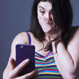 Nervous woman swearing into his mobile phone. The bad news, nega Royalty Free Stock Photos
