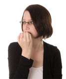 Nervous woman thinking. A nervous woman looks to the side while biting her fingernails Stock Photography