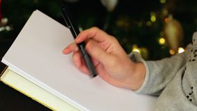 Nervous woman trying to write a letter. In room stock video footage