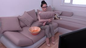 Nervous woman watching TV. In room stock footage
