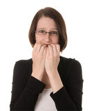 Nervous Woman on white. A nervous woman looks at the camera biting her fingernails Royalty Free Stock Photography