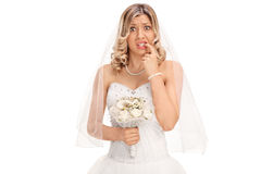 Nervous young bride biting her nails. And looking at the camera isolated on white background royalty free stock photography